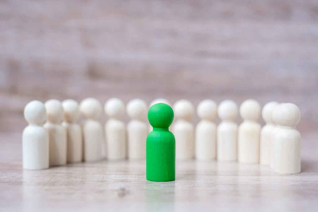 Green leader businessman with crowd of wooden men. leadership, business, team, teamwork and Human resource management concept
