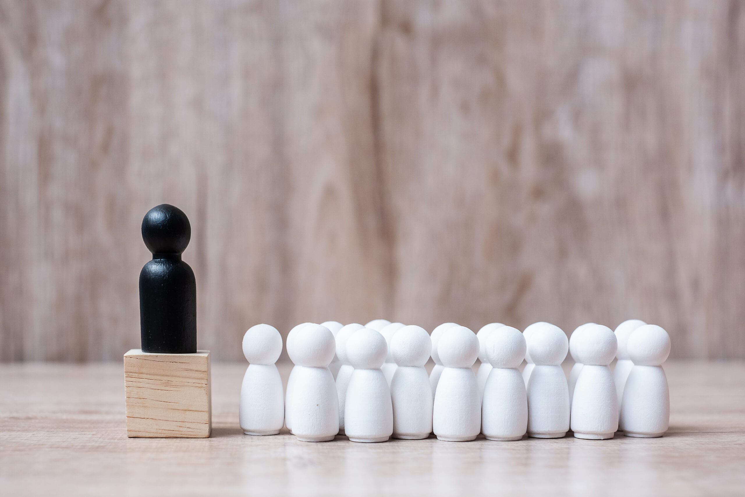 black leader businessman with crowd of wooden employees. leadership, business, team, teamwork and Human resource management concept